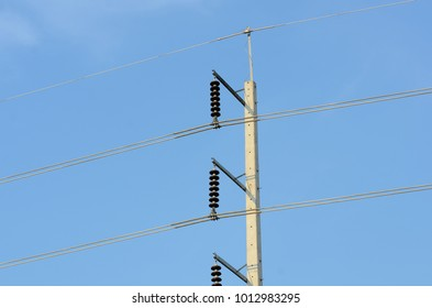 High-power tower Power transmission system.High voltage transmission line.high voltage pole Power transmission system With sky background image. High-voltage tower at blue sky background..