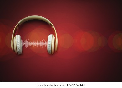 High-quality headphones with musik track on a red background