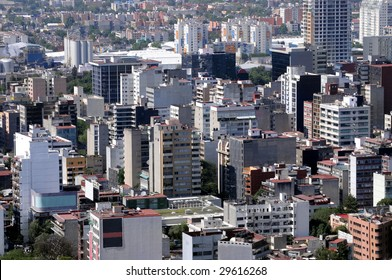 High-rise apartment blocks dotting the skyline of Mexico City, a metropolis of over 20 million people. A generic view of urban living that could be from anywhere in the world.