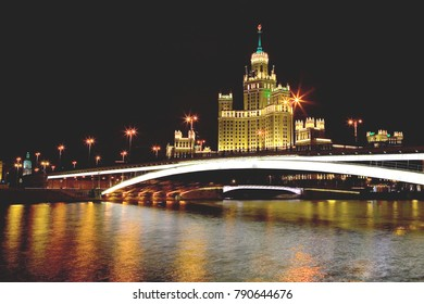 A high-rise building built during the Soviet era. At night.