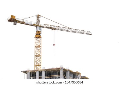 High-rise building crane with a long arrow of yellow color on a white background above a concrete building under construction with brick walls