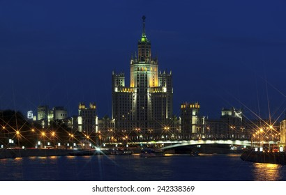 High-rise building in soviet style on embankment of Moscow River. Stalin's empire architecture. Evening summer panorama.