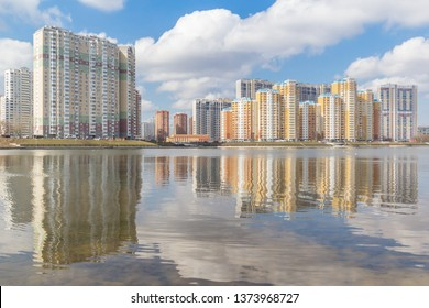 High-rise buildings on the river bank with reflection, Krasnogorsk, Moscow, Russia
