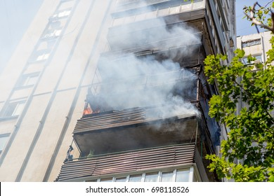 High-rise condominium or apartment burning. Fire in apartments of a large tenement-house.