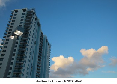 High-Rise Condominium at Dusk with Lights Illuminated in the Foreground