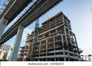 Highrise construction site at Brickell Miami near elevated Metrorail tram tracks
