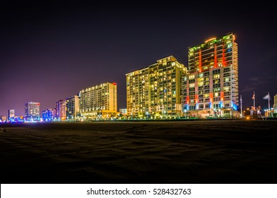 Highrise hotels on the oceanfront at night, in Virginia Beach, Virginia.