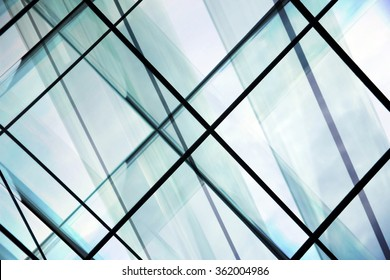 High-rise / multistory glass architecture. Multiple transparent wall, ceiling and floor panels in steel frames. Contemporary office building / modern interior design with all-over glazing.