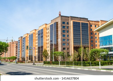 High-rise red brick house with windows, architecture.