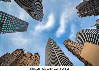 Highrises in San Francisco's Financial District, photographed from a low angle for dramatic perspective. Downtown of San Francisco look up, view up