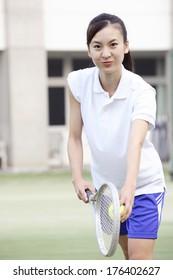High-school girl playing tennis