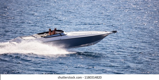 High-speed boat goes fast in calm sea. People enjoy the summer sport in the liquid environment.