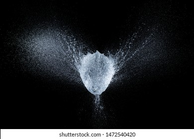 high-speed image of a balloon explosion filled with water at the exact moment of the explosion.