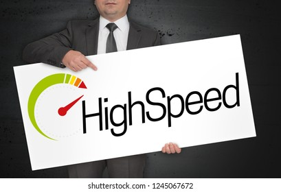 Highspeed poster is held by businessman.
