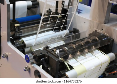 High-speed printing and cutting of labels on adhesive paper