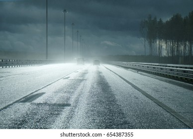 high-speed road after a rain with the falling rays of the sun