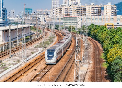 Highspeed train on the railway station at day time. Shenzhen. China.