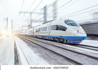 High-speed train rides at high speed in winter around the snowy landscape