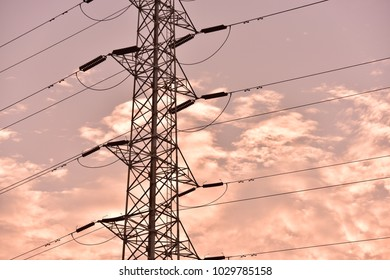 Hight voltage electric towers with sunset sky.The evening electricity pylon silhouette, it is very beautiful