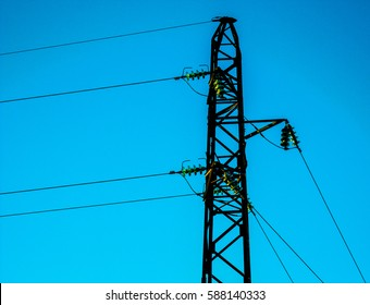 High-tension power line on blue isolated background