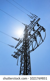 High-tension power line tower carry green electricity sun energy. Ironman business is transmission of renewable sustainable power to prevent climate change and heal world. Important grid modernization