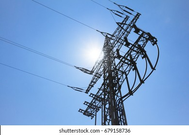 High-tension power line tower carry green sun electricity energy. Ironman business is transmission of renewable sustainable power to prevent climate change and heal world. Important grid modernization