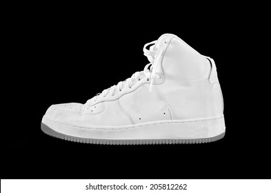 A high-top classic white and gray leather basketball shoe sneaker, isolated on black