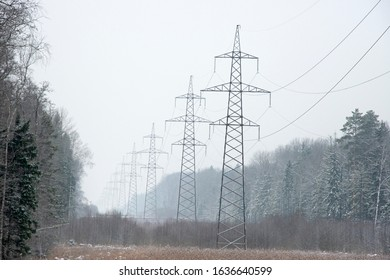high-voltage line in  frost forest
