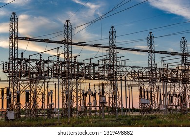 High-voltage lines of electrical distribution stations at sunset, Brazil's countryside.
