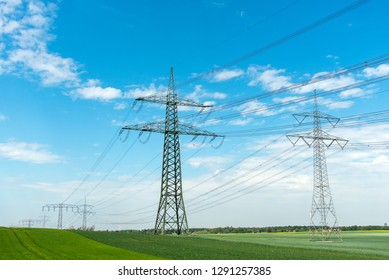 High-voltage lines on a sunny day seen in Germany