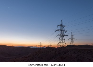 Highvoltage lines pylons in the field