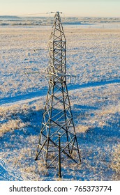 High-voltage mast castles on the background of snowy fields