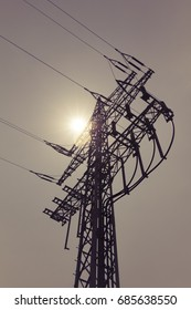 High-voltage power line tower carry green electricity sun energy. Ironman business is transmission of renewable sustainable power to prevent climate change and heal world. Important grid modernization