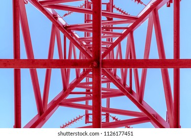 High-voltage power lines, bottom view. Red electricity distribution station .