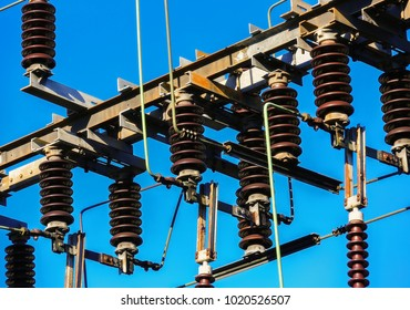 high-voltage power lines at electricity distribution station with connecting wires