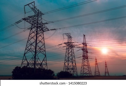 high-voltage  power lines at sunset. electricity distribution station. high voltage electric transmission tower.
