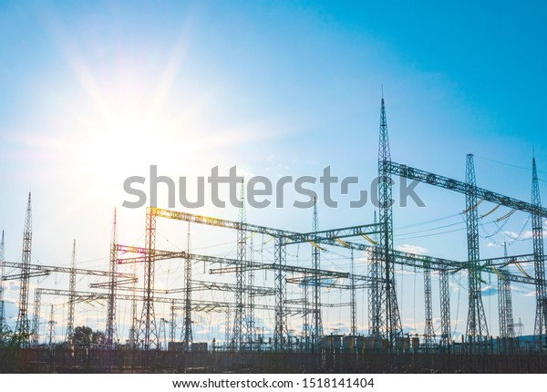 High-voltage powerful electricity towers with wires on a blue sky