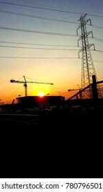 High-voltage pylon with evening atmosphere.