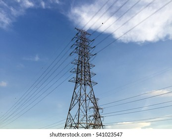 High-voltage tower over sky background. High voltage post. Power line.