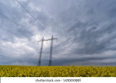 High-voltage towers and cables in agricultural fields. Rural country in South Moravia, Czech Republic.