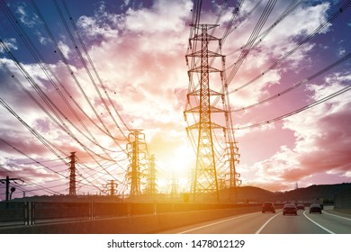 a high-voltage transmission tower, At sunset