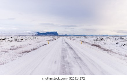 Highway 1 Iceland. Clear road covered in snow and ice