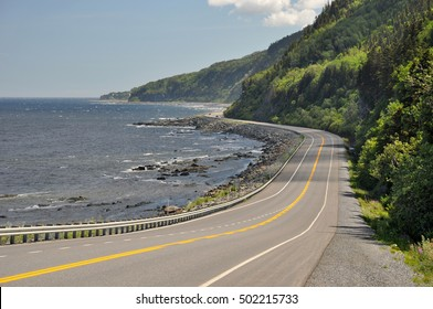 Highway 132 at the coast of Saint Lawrence River in Quebec, Canada. The route is part of the Gaspé Peninsula (Gaspésie)