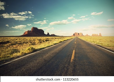 Highway 163 through Monument Valley at sunset, Arizona, Utah, Navajo Nation, USA, vintage style