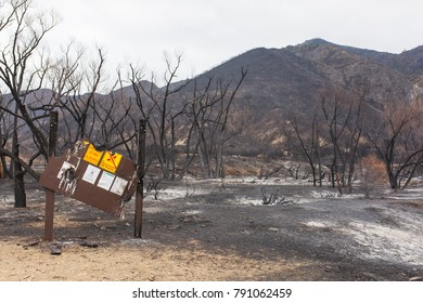 HIGHWAY 33, ROSE VALLEY, OJAI, CALIFORNIA - JANUARY 4, 2018: Campground information sign badly damaged by Thomas Fire in Rose Valley. Signs indicate high fire danger and fire restrictions