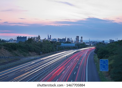 Highway A4 at a refinery and petrochemical industrial plant in Austria at dusk.