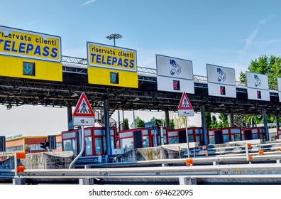 HIGHWAY ALESSANDRIA-TURIN, ITALY, CIRCA JULY 2017: a colorful toll booth in a sunny day. HDR effect.