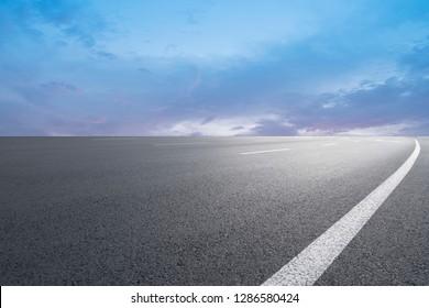 Highway Asphalt Pavement and Natural Landscape