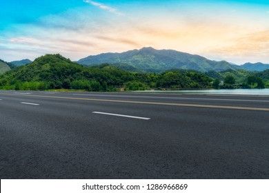Highway Asphalt Pavement and Natural Landscape