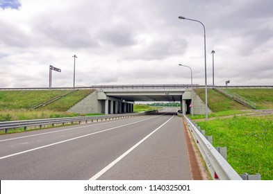 Highway asphalt road passes under the bridge of high-speed highway